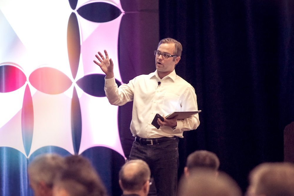 Benjamin Powers, VP of Sales for Visiting Media speaking at a conference