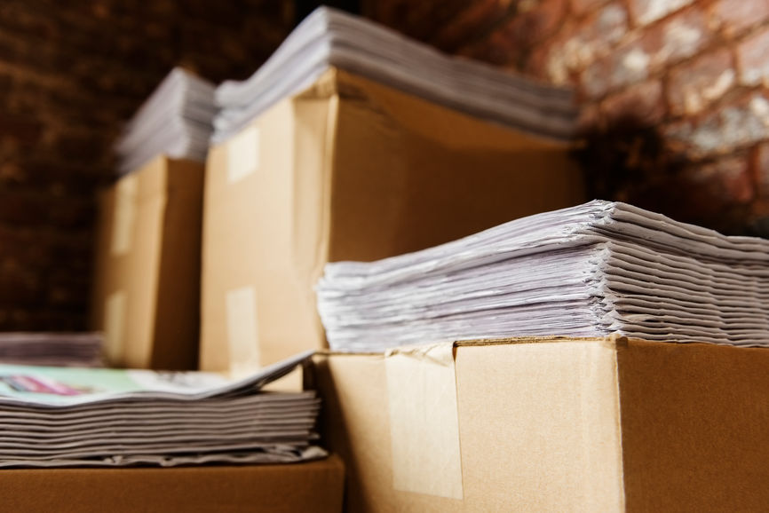 Stacks of paper in boxes
